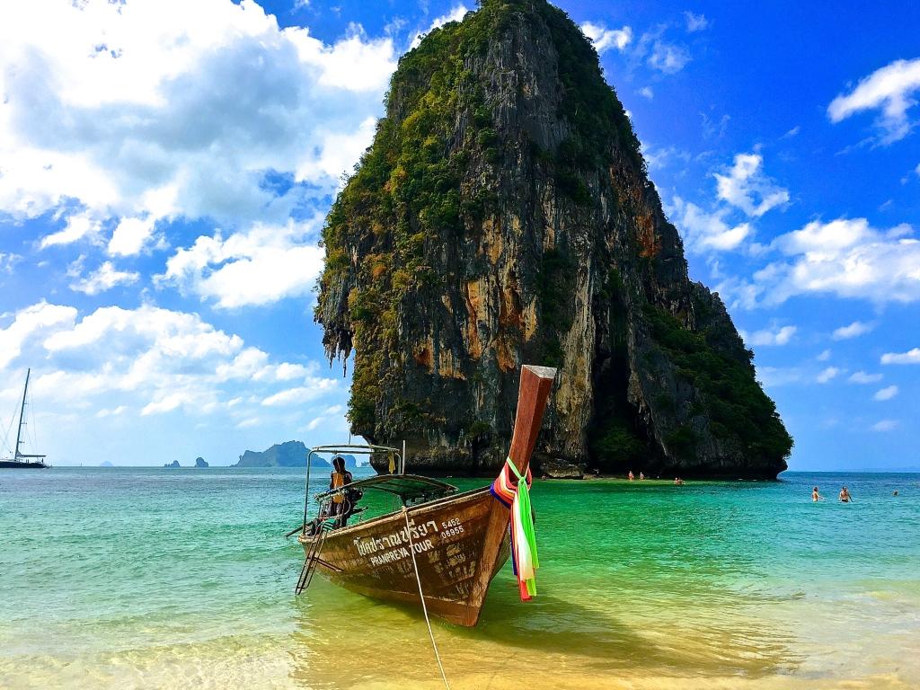 A long tail boat docked at Phra Nang Beach